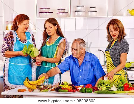 Big family cooking at kitchen. Grandfather and grandmother. Women cooking at home.