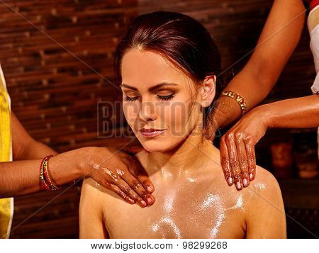 Young woman having neck Ayurveda treatment.Spa resorts in India