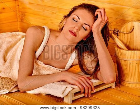 Young woman in sauna. Enjoyment of life