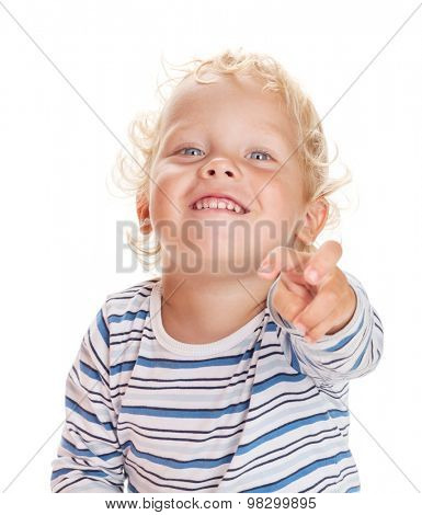 Happy baby shows his finger forward. Isolated on white background