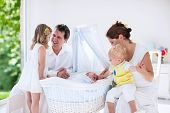 Постер, плакат: Family With Kids Playing With Newborn Baby
