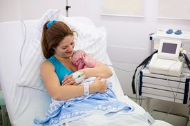 image of baby delivery  - Mother giving birth to a baby - JPG