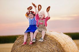 foto of pretzels  - Kids in traditional Bavarian costumes in wheat field - JPG