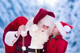 image of snow forest  - Santa Claus and children opening presents in snowy forest - JPG