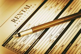 stock photo of rental agreement  - Renter Application Signing Concept - JPG