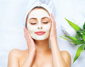 picture of cleanse  - Spa Woman applying Facial cleansing Mask - JPG