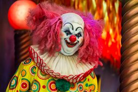 image of clowns  - Scary clown robot in clown mask on Halloween day - JPG