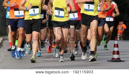 Runners During The Marathon With The Bib Number Written With 1