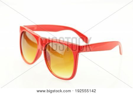 Close up of red eyeglasses on white background