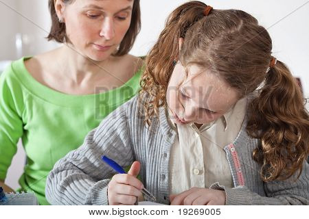 Girl Doing Prework With Her Mom