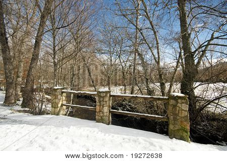 Snowy bridge at countryside