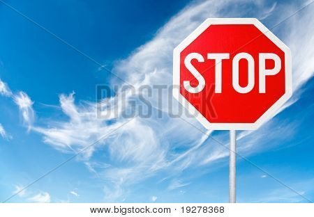stop sign with a cloudy sky