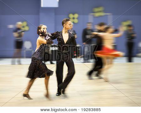 TOMSK, RUSSIA - FEB 14 : Couple dancing - Zaytcev Denis, 13 and Sadkovskaya Elizaveta, 12 (no 57) at sport dance competition of Tomsk region on February 14, 2011 in Tomsk, Russia.