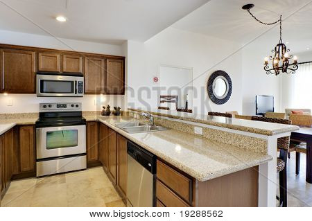 Kitchen view with range, microwave, and dishwasher