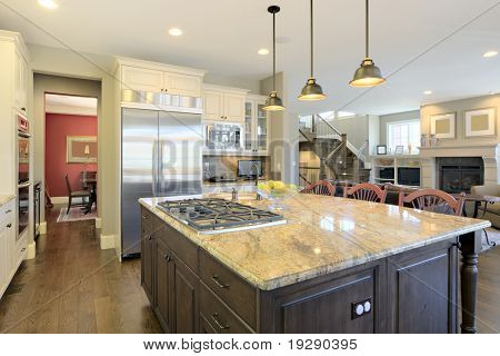 Luxury kitchen from angle overlooking center cooking area island.