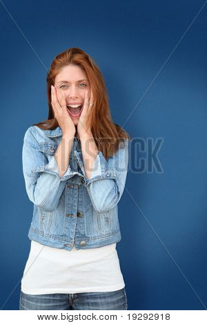 Woman on blue backgroudn with amazed look