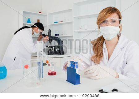 Two female scientists conducting an experiment