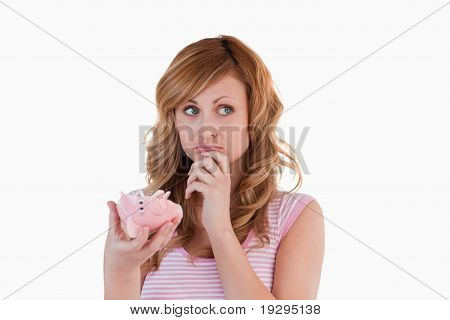 Woman perplexed concerning her broken piggybank