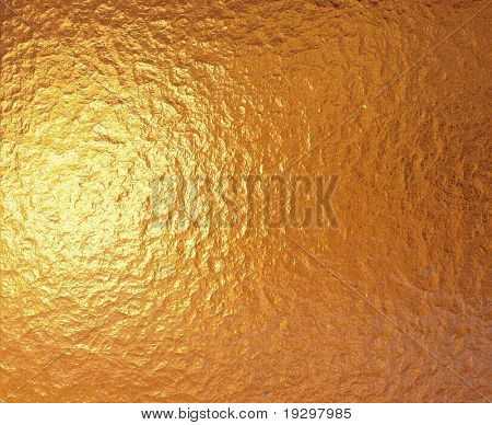 a very large sheet of fine crinkled gold aluminium foil