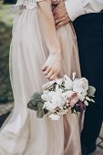 Stylish Wedding Bouquet. Modern Bride And Groom Holding Fashionable Bouquet Close Up In Park. Fine A poster