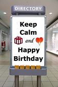 Keep calm and happy birthday sign inside shopping mall poster