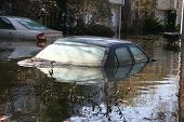 stock photo of katrina  - this photo shows a car completly submerged in the flooded waters of new orleans in the aftermath of hurricane katrina - JPG