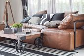 Wood Center Table With Wheel And Light Brown Leather Sofa In Industrial Style Decoration poster