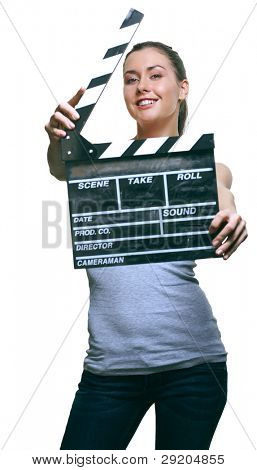 Attractive young woman with movie clapper board