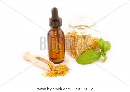 Dried caledula officinalis petals with macerated oil isolated on white