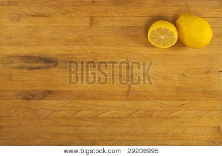 Lemons On Worn Butcher Block