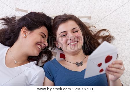 Young Teenagers Reading Love Letter