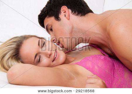 couple in bed during sex and tenderness