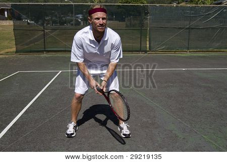 Tennis Player Stands Ready To Return A Serve.