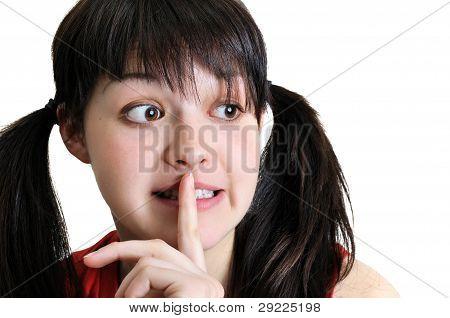 Young Woman Gesturing Shushing