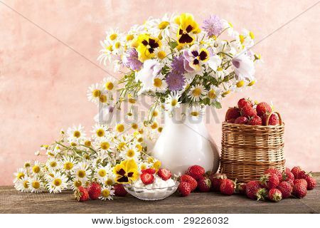 strawberries and bouquet of  flowers