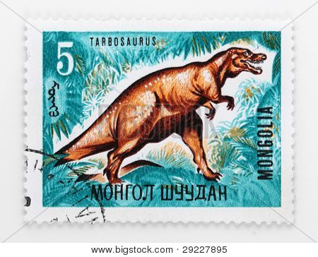 MONGOLIA - CIRCA 1972: A stamp printed in The Mongolia shows The Tarbosaurus a genus of tyrannosaurid theropod dinosaur that flourished in Asia about 70 million years ago, circa 1972.