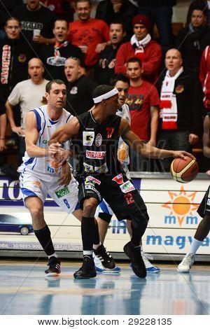 KAPOSVAR, HUNGARY - JANUARY 21: Balazs Szoke (white) in action at a Hungarian National Championship basketball game with Kaposvar (white) vs. Szolnok (black) on January 21, 2012 in Kaposvar, Hungary.