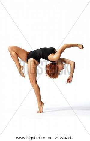 young and beautiful dancer posing on white background