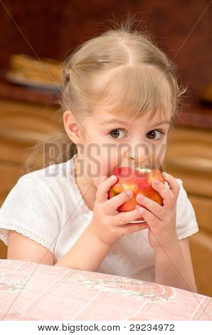 Child with an apple.