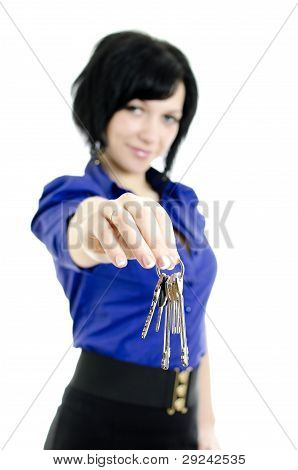 Portrait Of A Business Woman Holding Keys. Focused On Keys. Isolated On White Background