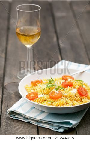 Plate Of Italian Pasta And Wine On Wooden Table