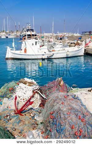 fisherboats with nets longlines buoy tackle in foreground at Formentera
