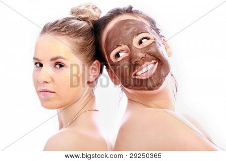 Beautiful Girl with chocolate mask on her face