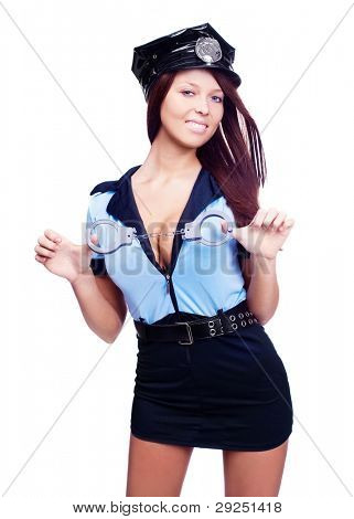 young sexy policewoman holding handcuffs,  isolated against white background