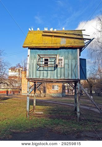 Blue Vintage Dovecote With White Pigeon On Roof, Urban Building Details