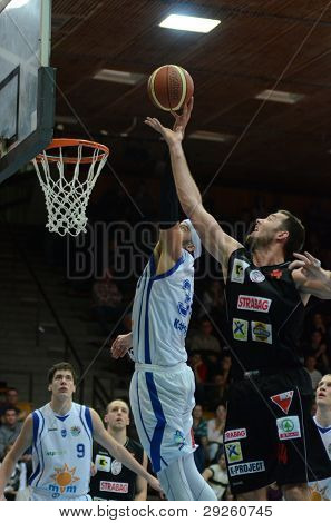 KAPOSVAR, HUNGARY - JANUARY 21: Michael Fey (C) in action at a Hungarian National Championship basketball game with Kaposvar (white) vs. Szolnok (black) on January 21, 2012 in Kaposvar, Hungary.