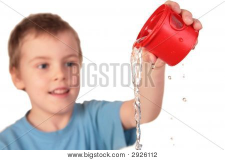 Boy Pours Out Water From Red Plastic Cup