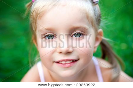 Portrait of a beautiful litle girl close-up