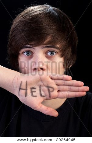 Scared teenager boy needs help - body language and communication concept