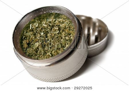 Marijuana grinder with weed on a white background